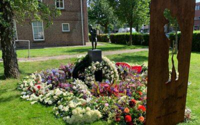 Floral Tribute Adorns Refugee Monument